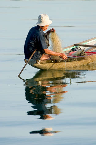 Fisherman on Huong Rivver (Hue City - Vietnam)