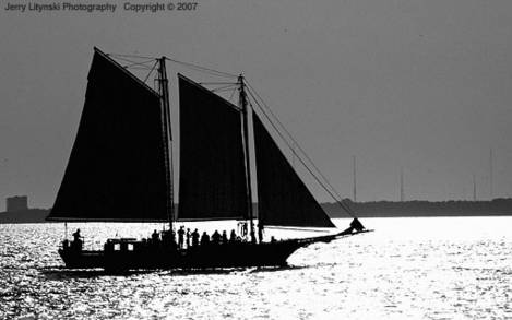 Sailing against bright water