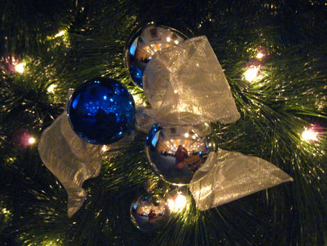 decorations of blue on a green Christmas tree...