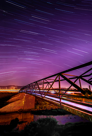 Light trail bridge with Star Trails