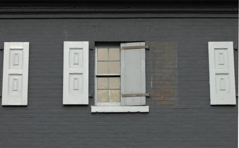Windows on a gray wall