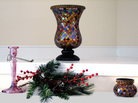 A VASE ON THE FIREPLACE MANTLE AT CHRISTMAS