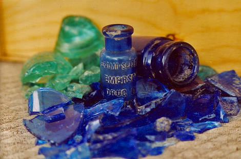 dirty dirt,yard glass,bottles