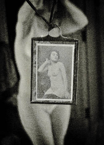 self portrait holding nude picture
