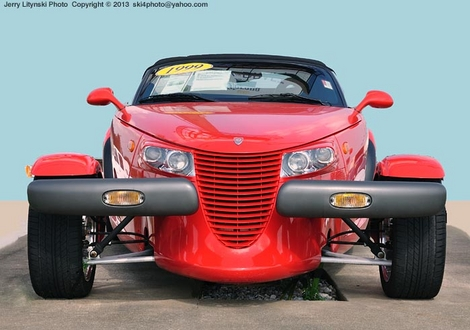 A red 1999 Plymouth Prowler roadster