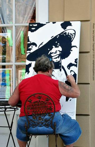 A sidewalk artist at work