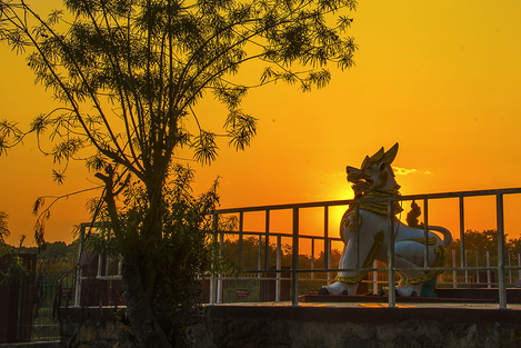 Myanmar's legendary lion statue at sunset